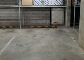 Secure indoor parking spot with storage.jpg