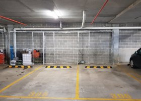 Car spaces with Multi-use storage cages.jpg