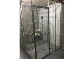 Secure underground parking cage storage New aptmt.jpg