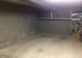 Lock-up storage cage in secure building.jpg