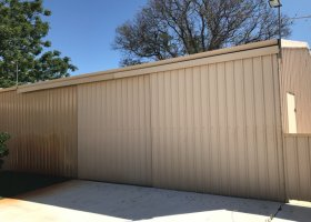 Backyard Indoor storage shed or parking space behind two secure gates avaliable.jpg